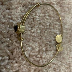 Alex and Ani gold bracelet w/ blue sliding stone